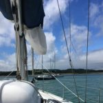 Careful pilotage into Newtown Creek on a perfect sailing day